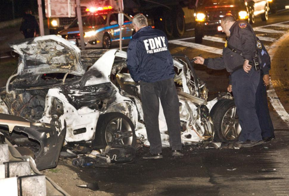 Fire marshals investigate wreck on Interstate 95 in the Bronx. An off-duty police officer driving the wrong way was killed when he collided head-on with a tractor-trailer.